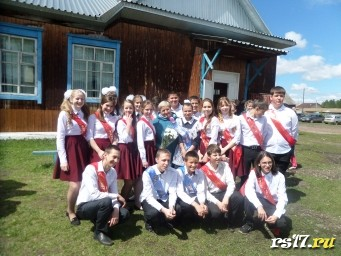 С нашей первой учительницей - Евгенией Павловной.